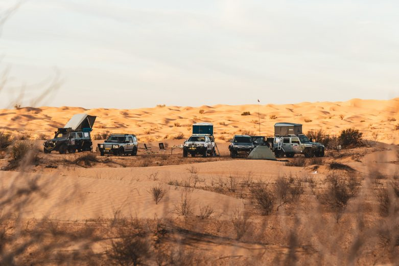 off road vehicles camped in the desert